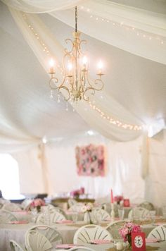 adding a chandalier to this tent is a great touch! #tent #wedding #reception