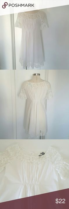 "Cielo Lace Cotton Dress Very girlish look cotton fresh with accents of lace one neckline and sleeve , of white, 100% cotton,  doesn't have lining. Fabric is a little bit see through. New condition never been worn but doesn't have tag on it. Measurements are length 34"" bust 38"" hand wash in cold water. Cielo Dresses"