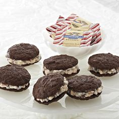 Ghirardelli Creamy Peppermint Chocolate Sandwich Cookies | Handcrafted chocolate cookies are sandwiched around a filling of creamy peppermint icing for a beautiful holiday treat.