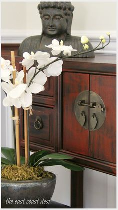 Zen is in the Details - Orchids and Buddha with a Chinese chest. the east coas. - Zen is in the Details – Orchids and Buddha with a Chinese chest. the east coast desi – - Asian Furniture, Chinese Furniture, Oriental Furniture, Asian Inspired Decor, Asian Home Decor, Asian Interior Design, Asian Design, Japanese Interior, Interior Colors