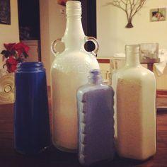 Pour paint in antique or liquor bottles in coordinating colors