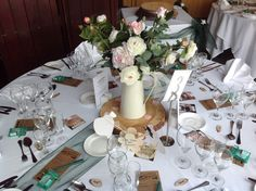 Rustic jugs on wooden log slices are perfect for a rustic/vintage wedding centrepiece.  Available to hire in The Midlands from Make It Special Events. http://www.makeitspecialevents.co.uk/