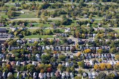 Detroit by Air - NYTimes.com: Alter Road, center, serves as a dividing line between vacant lots in Detroit and the suburb of Grosse Pointe Park, in the foreground, the city's wealthier neighbor.