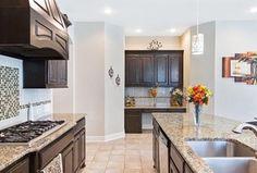 Craftsman Kitchen with Pendant light, limestone tile floors, Built-in bookshelf