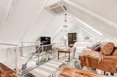 Diseño Escandinavo: Un ático elegante en Norrbackagatan