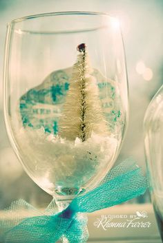 Create a perfect Christmas scene with a bottle brush tree. | 24 Clever Things To Do With Wine Glasses