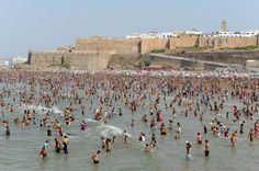 A crowd of people gather at the beach in Rabat during a heat wave in Morocco on July 15, 2012.