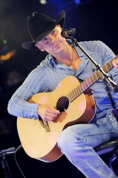 Country boys in tight blue jeans: Kenny Chesney