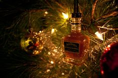 Cute idea for mini liquor bottles! Jack Daniels Ornament-- Jack Daniels Single Barrel Tennessee Whiskey Themed Christmas Tree Ornament.. $13.00, via Etsy.