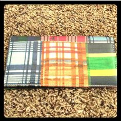Picnic Plaid Checkbook cover Super cute picnic plaid checkbook cover with little ants. I have listed this unbranded because I'm not sure of the authenticity but it matches the Dooney and Bourke madras picnic plaid line perfect, but like I said there is no brand and I can no list it as one without knowing for sure. So please be aware of this  Preloved item but Good condition Bags Wallets