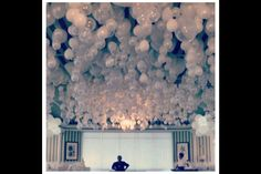 Balloons on ceiling (marble in balloons so it hangs upside down)