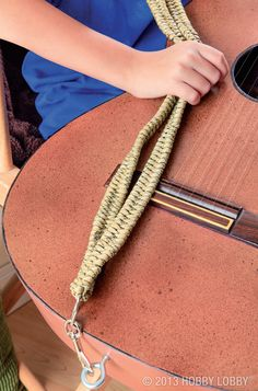 This reptile-reminiscent guitar accessory is definitely noteworthy. We used a fishtail knot formed on D rings for the strap. Then we added spring snap clasps to attach it to the instrument. Whether your skills rival those of Hendrix or you can barely pick out a tune, you'll be strumming in style with this show-stopping strap.