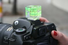 The Level Camera Cube - Slip this into your DSLRs hotshoe and 3 bubble levels help you get perfectly straight photos every time.