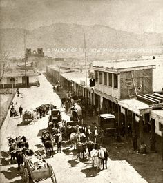 Wagon trains on San Francisco Street at the Plaza in Santa Fe, New Mexico ca. 1869 - 1871.    Photograph by Nicholas Brown    Negative # 070437
