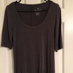Soft & Sexy Jegging Tee Work once, like new condition! It's a dark, warm/washed grey. Comes a 1/4 way down the thigh. Very soft and stretchy. Has slits in the sides. American Eagle Outfitters Tops