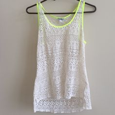 EXPRESS- White Lace Blouse w/bright green trim Worn a couple of times, perfect condition. See-through so I wear a bandeau or tank underneath. Great for summer! The pop of bright green is a perfect touch. Express Tops Blouses