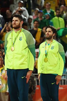 Gold medalists Alison Cerutti and Bruno Schmidt Oscar of Brazil stand on the…