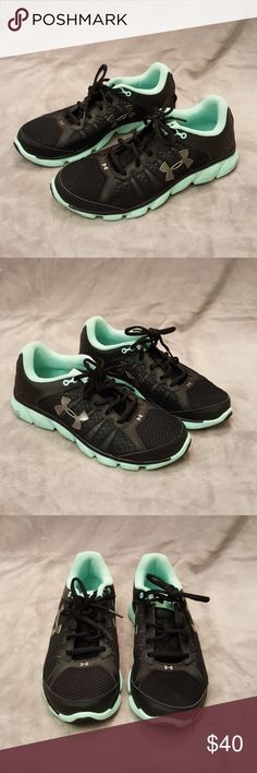 Teal and Black Tennis Shoes I bought these online but they are not true to size and they fit right on, they say they are a 9.5 but they fit like a 9. They are super comfortable. The only reason I'm getting rid of them is because I like my workout shoes to fit a little bigger. They are brand new, with box  💕Please feel free to make reasonable offers, I am open to negotiation and bundling.💕 Under Armour Shoes Sneakers