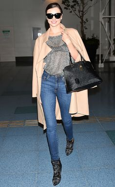• Miranda Kerr is all legs and see-through sparkles upon arrival at Tokyo's Haneda Airport •