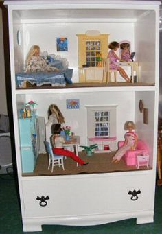 Good idea. Using an old dresser for a dollhouse.  Save $