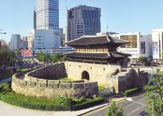 "Seoul, the capital of the Joseon Dynasty, was protected by a long stone wall with eight gates, two of which, Sungnyemun (Namdaemun or South Gate) and Heunginjimun (Dongdaemun or East Gate), can still be seen today. The first, literally ""Gate of Exalted Ceremonies,"" is famous for being the Korean National Treasure No. 1, while the second, Heunginjimun, is the only one of the eight fortress gates protected by a semicircular gateguard wall."