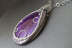 A unique, handmade, wire wrapped pendant with Fire Agate  Pendant was made by Me, using an extremely labor-intensive and precise wire-wrapping technique, with sterling silver wire. Strongly oxidized and polished to emphasize the braid tangles.  Dimensions of pendant:  length: 6,2 cm 2.44 inch width: 3,6 cm 1.41 inch  You receive this unique pendant in jewelry box, so it is ready to be a gift.  ---------On this auction you buy pendant without chain.---------   Refunds and Exchanges:  If you…