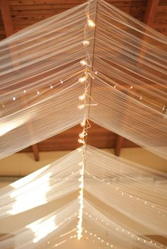 Use clothes-drying line or heavy gauge wire to hang fabric and lighting on back porch. Jason will have ideas.