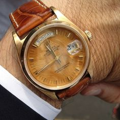 Brendan Monaghan's gorgeous's vintage Rolex with wood dial.