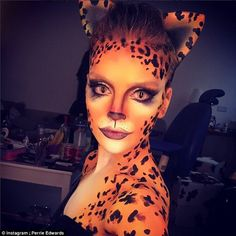 Pawtrait! Perrie Edwards, 22, posed for a photo of her covered in leopard-print body paint, as she aimed a thinly veiled dig at ex-fiancé Zayn Malik by captioning the image 'Cheetahhhh!'