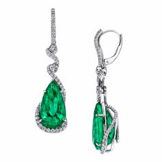 Emerald and diamond earrings from gem and jewelry company, Omi Privé, are handcrafted with 13.06 total carats of pear-shaped emeralds accented with 1.05 carats of brilliant diamond rounds set in platinum