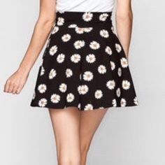 Tilly's Daisy Skater Skirt New/Unused black Daisy print skater skirt from Tilly's. High waisted. But can be folded down into non high waisted. Feel free to make an offer. Tilly's Skirts Circle & Skater