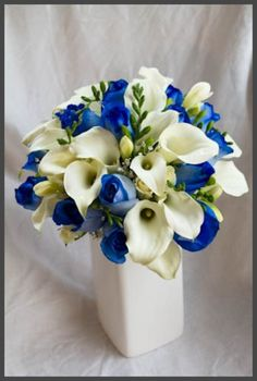 calla lilies and blue roses..reception wedding flowers,  wedding decor, wedding flower centerpiece, wedding flower arrangement, add pic source on comment and we will update it. www.myfloweraffair.com can create this beautiful wedding flower look.