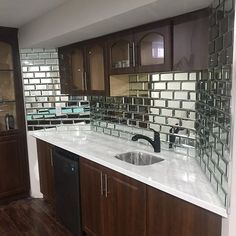 Mirrors add light, shine, and sparkle. It also adds the illusion of space. These versatile tiles help create an elegant, custom look for any decor. Mirror Tiles, Mirrors, Subway Tile, Illusions, Kitchen Cabinets, Sparkle, Elegant, Create, Home Decor