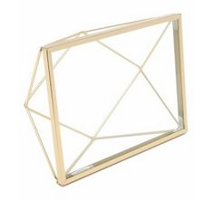 This pretty frame means that shopping for mom's gift = done. Umbra Prisma 4x6 Frame, $15; shopbop.co... - Provided by Marie Claire