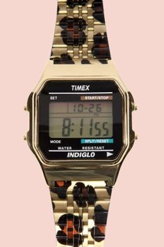 I use to make fun of my dad for wearing the silver one! Ha! Now I want one!  Leopard print Timex Retro