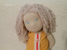 Maya is Waldorf inspired doll made from natural materials. She is about 23 tall (60cm) and she weighs about 1.2 lb (almost 0.6kg).  She is filled with wool and her skin is made of highest quality Turkish combed cotton interlock. Hair is made of young wool (70%) and cotton (30%) yarn. All her clothes is handmade: Pants- linen and cotton lace Tunic- linen, cotton lace, wooden buttons Skirt- cotton, cotton lace Knitted sweater- young wool and cotton yarn, cotton lace, wooden buttons Knitted…