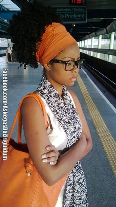 Burnt orange head wrap and beautiful coiled hair.