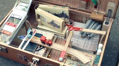 Small Rube Goldberg Machine in Briefcases, With the ability to fit inside two old briefcases, Melvin the mini Machine shows the same careful and intricate Rube Goldberg system carrying out the simple task as inefficiently as possible.