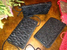 Black clutches in satin, beads and rhinestones