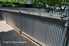 corregated metal fence custom steel light fixture arches over the back patio. Corregated Metal, Corrugated Metal Fence, Wooden Fence, Metal Roof, Metal Pergola, Rustic Fence, Metal Fences, Aluminum Fence, Bamboo Fence