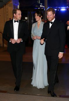 """Prince William, Duke of Cambridge (L), Catherine, Duchess of Cambridge (C) and Prince Harry (R) attend The Cinema and Television Benevolent Fund's Royal Film Performance 2015 of the 24th James Bond Adventure, """"Spectre"""" at Royal Albert Hall on October 26, 2015 in London"""
