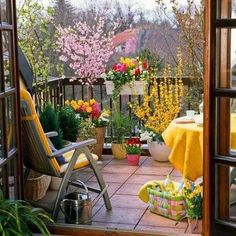 outdoor seating areas and ideas for outdoor home decorating with flowers  Love the pops of yellow, so happy and sunny !! ☀️