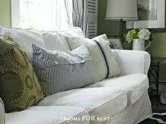 Bold Farmhouse Living Room. Green, navy, tan, and white- I love these colors.