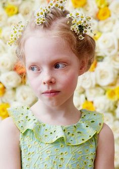 Delicate flowers tucked into delicate braids make a picture perfect flower girl. #flowergirl #SoCozyWeddingLooks #CozysBraidBar