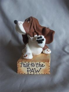 Talk to the Paw! This is SO Kenny. When you rub his paw he always turns his head!