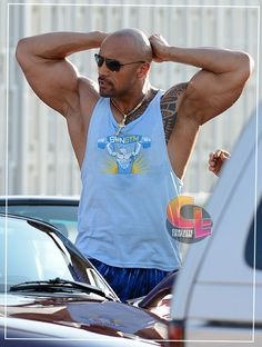 Dwayne Johnson reaches behind his head to  find that someone has just cut off his ponytail