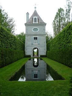 "House & Home ""A narrow garden with a striking folly, this reflecting pool gives depth to the garden and creates a magical reflection."""