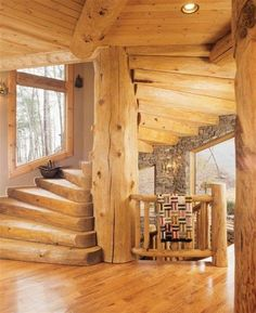 Awesome staircase inside a Log Cabin style house.