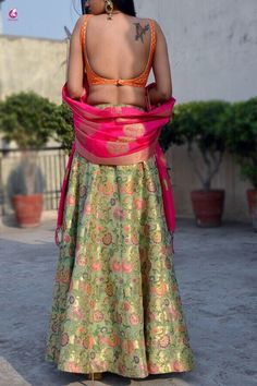 Dazzle up in style in this beautiful multicolour brocade lehenga by Colorauction. The skirt is made from multicolor brocade and comes with a stitched orange brocade padded blouse along with chanderi zari woven magenta dupatta.Team it with heels to look go New Saree Blouse Designs, Fancy Blouse Designs, Brocade Lehenga, Anarkali, Stylish Blouse Design, Stylish Sarees, Kurti Designs Party Wear, Indian Designer Wear, Beautiful Outfits
