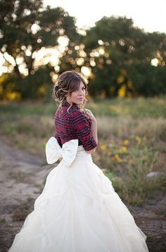 a flannel over your wedding dress... I really like this look for some reason. It's uber chic but down to Earth.